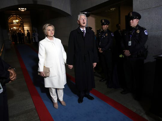 Former secretary of State Hillary Clinton and former President Bill Clinton arrive on the west front of the U.S. Capitol on Jan. 20, 2017, for the inauguration of President Donald Trump.