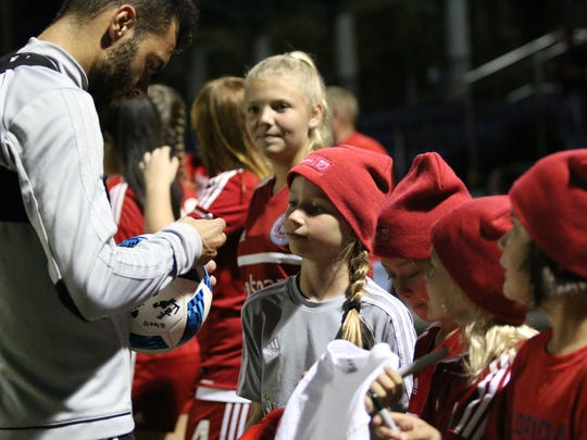 Recent Chicago Fire addition Nemanja Nikolić signs autographs for Florida Fire Juniors players and fans during the Chicago Fire's preseason training camp at Florida Gulf Coast University on Thursday, Feb. 2, 2017.