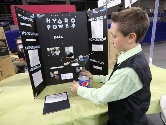 Kendrick Cryer tells about his experiment with Hydro Power. The work of about 700 public, private and home-schooled students from Lee and Charlotte counties were on display at the annual Thomas Alva Edison Kiwanis Science & Inventors Fair at FGCU's Alico Arena.