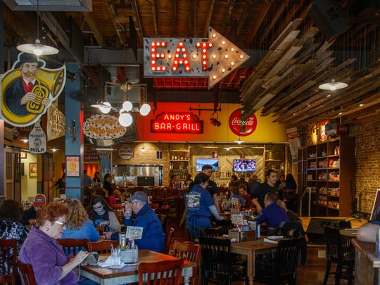 Aged wood and exposed brick offer vintage ambiance that complements the Southern-style food at Puckett's Grocery, now open in Murfreesboro.