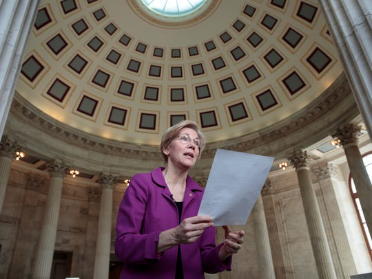 Holding a transcript of her speech, Sen. Elizabeth