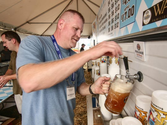 Vendor Bob Dreibelbis pours beer into a specialty glass during the 38th annual Oktoberfest Sunday, Sept. 18, 2016, at Delaware Saengerbund in Newark.