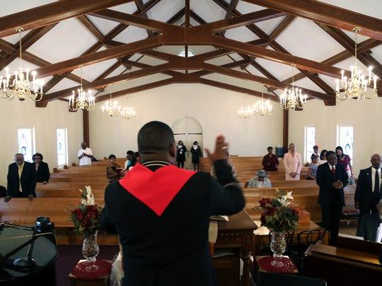 Reverend Reggie Garrett leads the service at Jubilee Baptist Church.