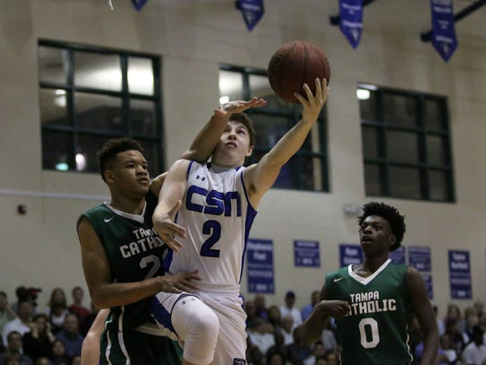 Jacob Siegel reaches for the layup during the 5A regional semifinal between CSN and Tampa Catholic at Community School of Naples on Tuesday, Feb. 21, 2017. Tampa Catholic defeated the Seahawks 64-60.