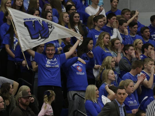 Oshkosh West fans cheer for their team during a game against Oshkosh North in February of 2017.