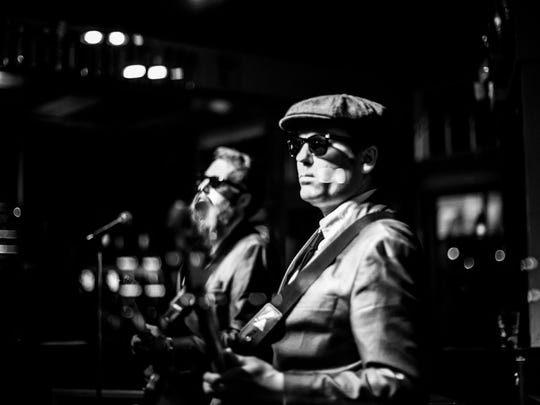 Luke Awtry's photos of musicians such as The High Breaks will be on display this month at the Mule Bar in Winooski.