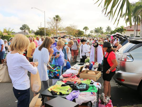 File: Treasure hunters descend upon the San Marco Catholic Church parking lot for the Treasures in the Trunk event.