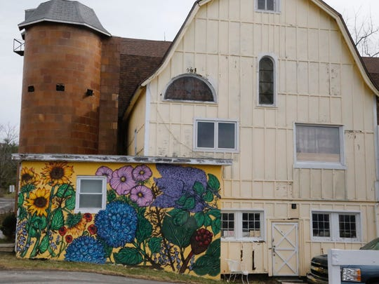 The Yellow Barn at La Tourelle features a mural painted