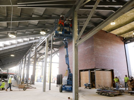 """A day before Opening Night, plenty of work was under way Thursday inside renovated M.L. """"Tigue"""" Moore Field at Russo Park."""