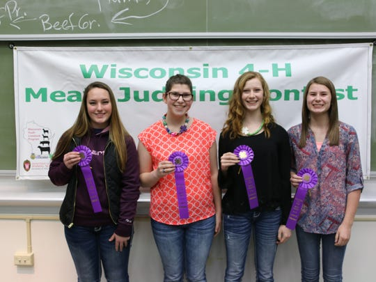 Emilie Pauls, Stephanie Witberler, Kailen Smercheck and Cortney Zimmerman were the top team Feb. 18 in the state 4-H Meats Judging Contest.