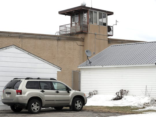 The south wall of the Green Bay Correctional Institution runs along the backyard of homes on Coolidge Street in Allouez.
