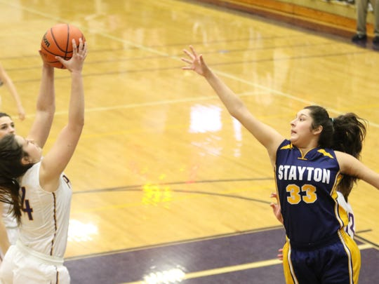 Stayton's Marri Martinez-Pallares (33) reaches for the ball against Marshfield on Saturday, March 4, 2017.
