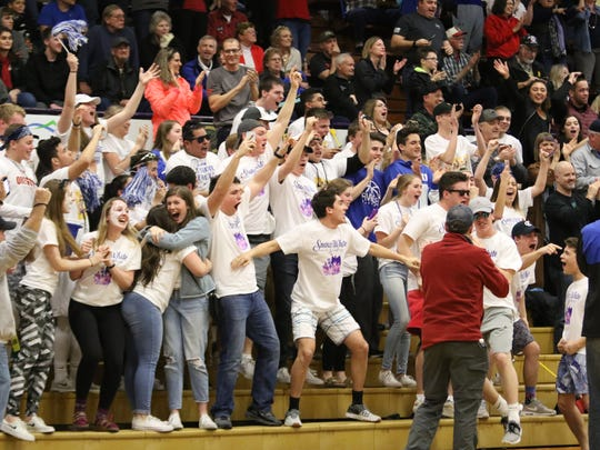 Blanchet's student section celebrates after the girls basketball team won the OSAA Class 3A state championship.