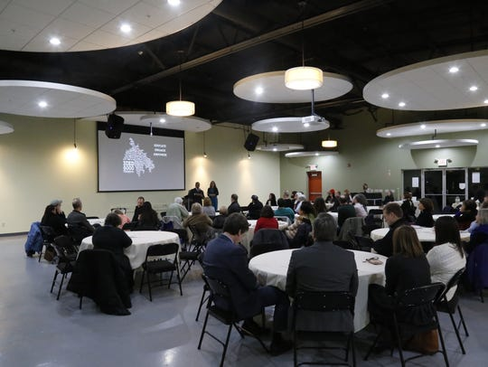 About 50 people attended a conversation with Ithaca