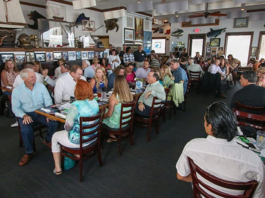 Guests enjoy their meal at the inaugural Local Celebrity Lunch benefiting Donate Life Florida on April 3, 2016, at Chuck's Seafood in Fort Pierce.