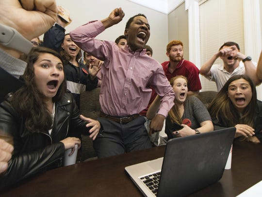 Jared Hunter, center, and his campaign staff react