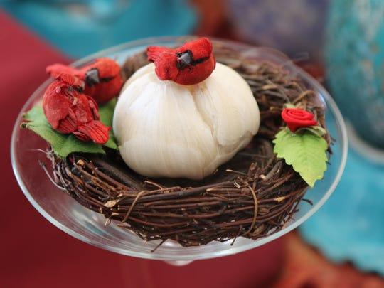 Garlic, symbolizing medicine, on the Haft-Seen table