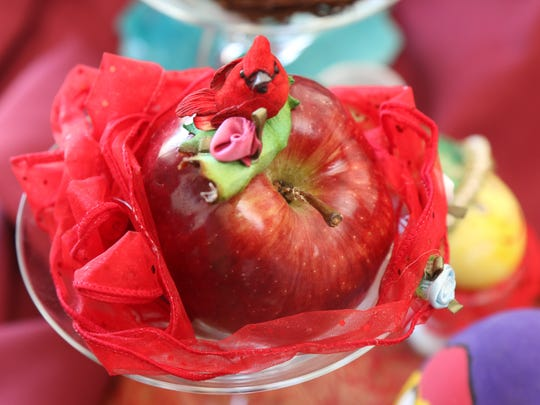 Apples on the Haft-Seen table symbolize health and beauty.
