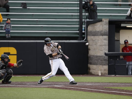 Iowa first baseman Jake Adams launches a solo homer in Tuesday's 6-5 win over Grand View at Duane Banks Field.