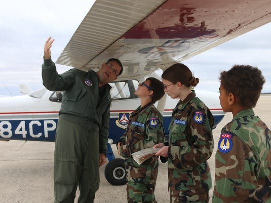 Capt. J. Anthony Plattsmier, a pilot from the Col. Joe W. Kittinger Phantom Senior Squadron, explains how to do a pre-flight inspection to Three Rivers Composite Squadron Cadets Airman Caleb Premo, Airman Basic Madeline Garber, and Airman Elijah Baldwin.