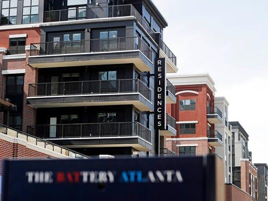 Newly-built private residences sit across from SunTrust Park, the Atlanta Braves' new baseball stadium in Atlanta, Wednesday, March 29, 2017.