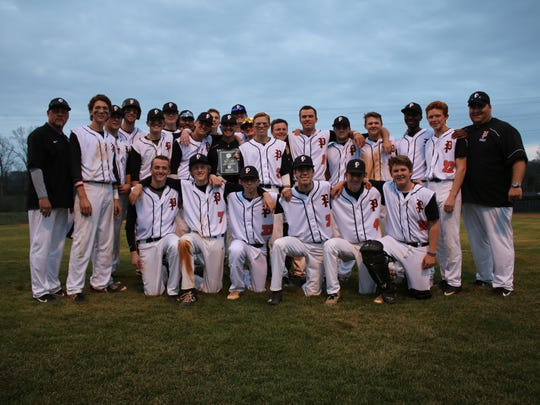 Powell coach Jay Scarbro poses with his team after notching his 100th win as Panthers coach following a 13-3 victory over Central on March 24.