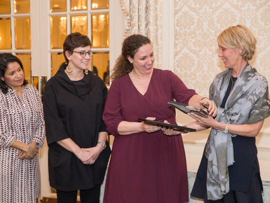 Members of the Morris Educational Foundation receive