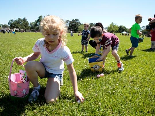 Children hunt for eggs during an Easter egg hunt in 2017.