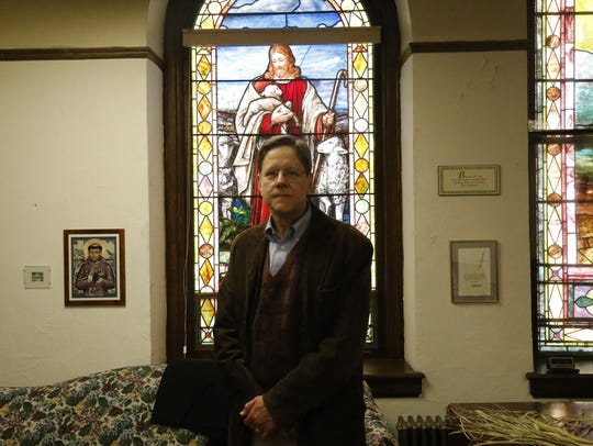 Senior Pastor John McNeill poses in an office at St.