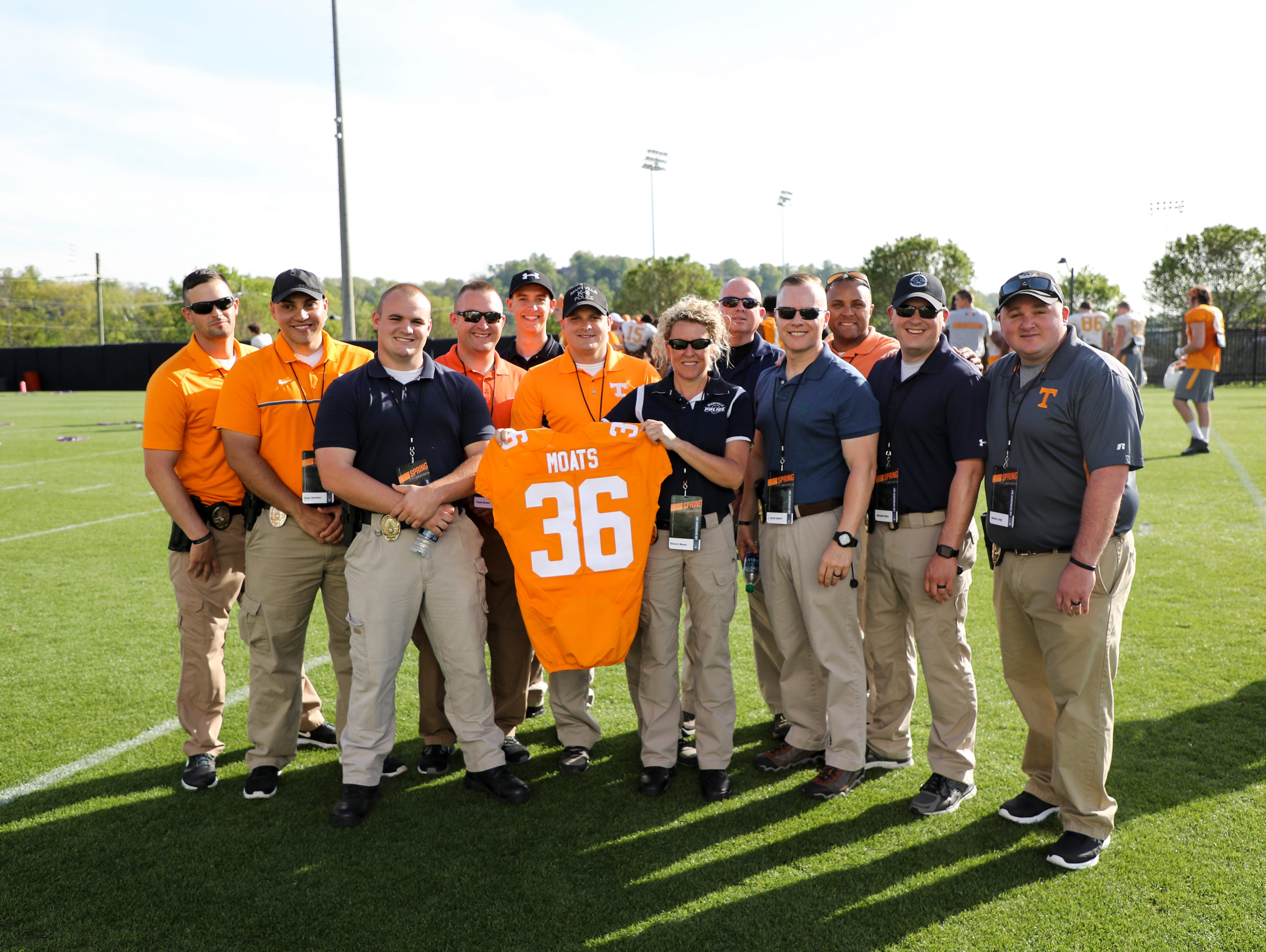 The Marvyille Police Department Pose With A Tennessee Football Jersey
