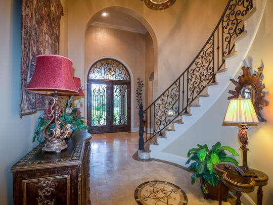The grand entrance features marble floors and a beautiful