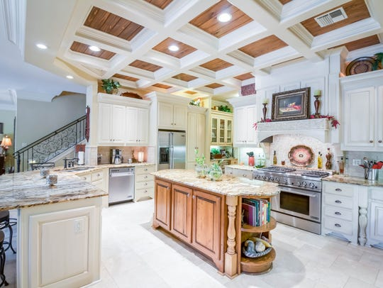 The gourmet kitchen features top of the line appliances