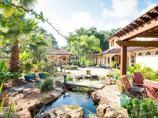 The waterfall and pergola create a backyard oasis.
