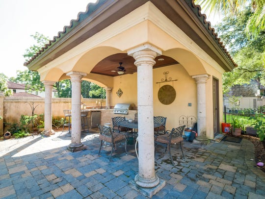 The patio and landscaped grounds create a peaceful