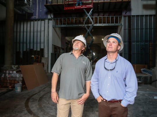Contractors David Stinson and Stuart Billeaud inside the new St. Pius X Church in Lafayette Tuesday, April 18, 2017.