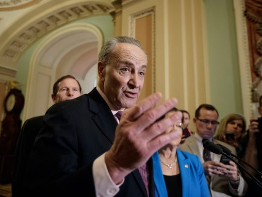Senate Minority Leader Chuck Schumer speaks to reporters