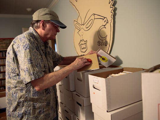 DJ/librarian Dan Phillips looks through boxes in his 6000 plus record collection at his home in Lafayette Weds., April 19, 2017.