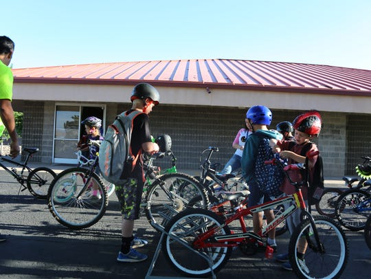 Students at Sunset Elementary School arrive on bicycles