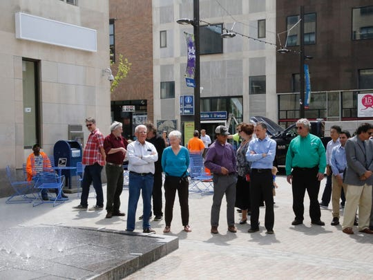 Residents look at the completed fountain.