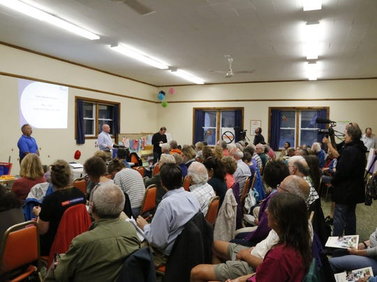 About 100 people attended a public information session