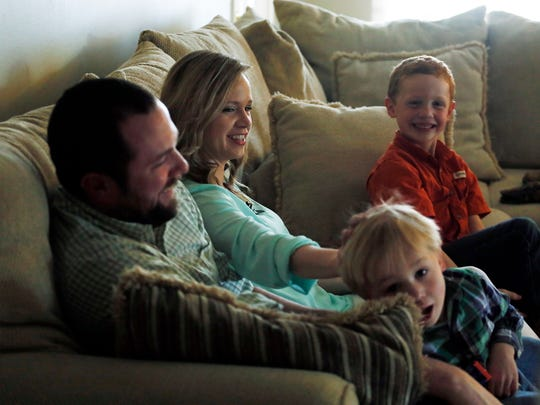 Jeannie, center left, and Justin Miller play with their sons Blake and Luke at their home in Flowood.