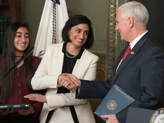 Seema Verma is sworn-in as Administrator of the Centers for Medicare and Medicaid Services by US Vice President Mike Pence, beside Verma's daughter Maya, in the Eisenhower Executive Office Building at the White House complex in Washington, DC, USA, 14 March 2017.