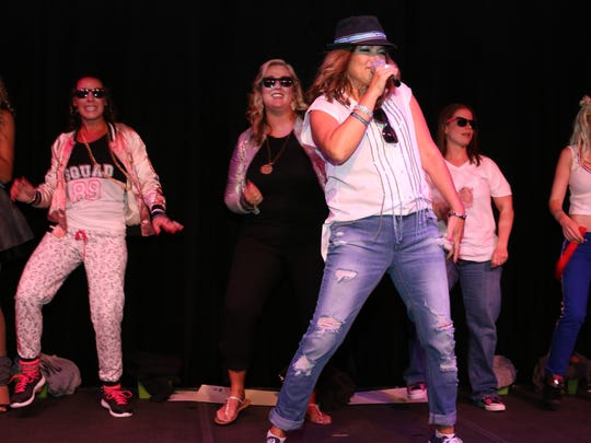Team Tommy Foundation Board of Directors warming up the crowd with their mash-up song. Featured are Jes Courtemanche, Dana Worthington, Laurie Boyer, Danielle Gajewski, Michelle Leckenbush with Deb Pizzimenti on the mic.