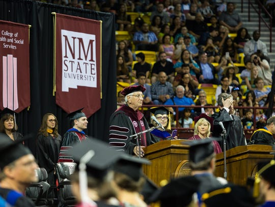 NMSU Chancellor Garrey Caruthers speaks to the graduating