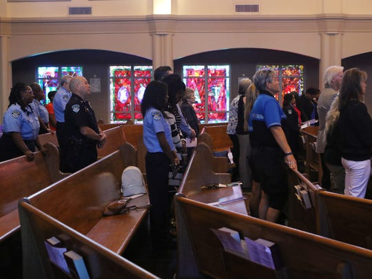 Officers gather at an annual Blue Mass to honor officers killed in the line of duty at Jesus the Good Shepherd in Monroe, Tuesday, May 16, 2017.