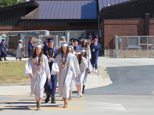 The 2017 graduating class at Water Canyon High School in Hildale head to the graduation ceremony on Monday, May 22, 2017.
