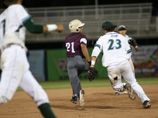 Seacrest third baseman Erick Chavez chases down runner Edel Morales during the FHSAA Class 2A semifinal against Deltona-Trinity Christian Academy at Hammon Stadium in Fort Myers on May 24, 2017.