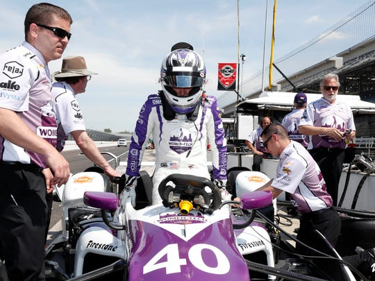 Verizon IndyCar Series driver Zach Veach gets in his