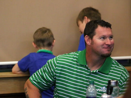 Rusty McKee smiles after learning who FGCU will face in the regional at the FGCU baseball program's NCAA watch party in the Alico Arena Hospitality Suite on Monday, May 29, 2017. The coach will say goodbye to the program after 14 years to spend more time with his family.