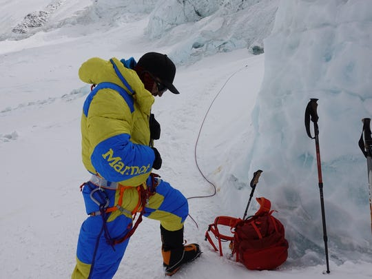 Andy Anderson of Cedar Falls gets roped on to a fixed line for the initial ascent up the north ridge of Mount Everest.